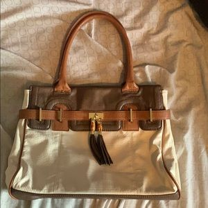 Brown and cream colored purse with tan straps